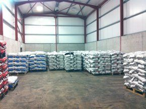 Potatoes stored in a cool and dry warehouse prior to deliveries
