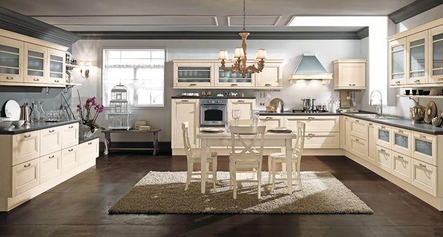 Cucina tutta di legno,suolo,mobili e rivestimento