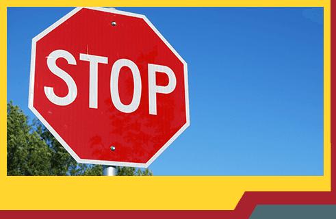 Gill's Garage Currrumbin Services Stop Sign