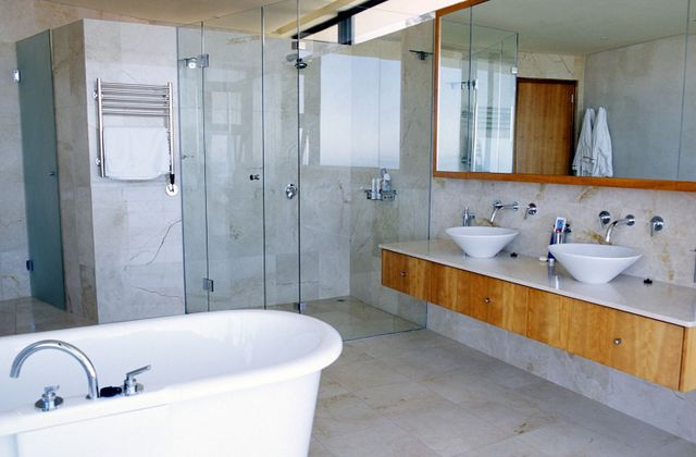 Woman in a bathroom done by a quality tilers in Northland