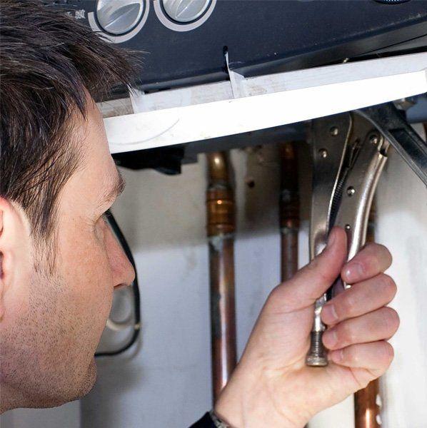 man fixing boiler