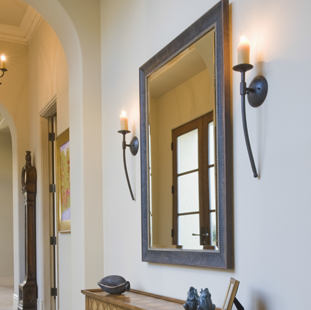 A large mirror that's hung on a wall