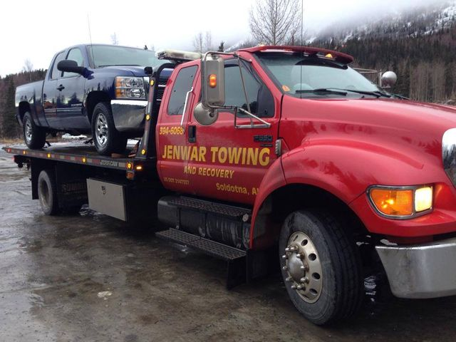 Our tow truck picking up an SUV