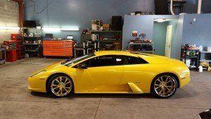 Modern yellow car in the garrage
