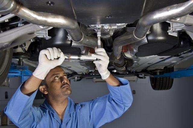 A professional repairing a car