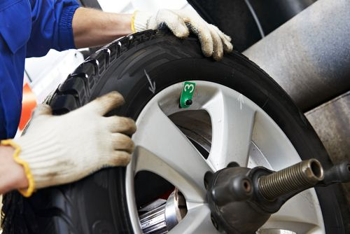 One of our experts installing new tyres on a car in Rainford