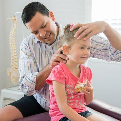 Adrian Chiropractor Treating Patient