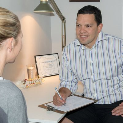Adrian Chiropractor Consulting with Patient