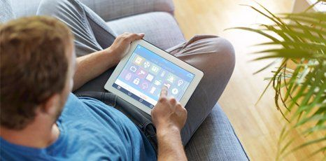 man using electronic tablet