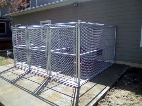 Family next to a fence done by our fencing contractor in Newark, OH