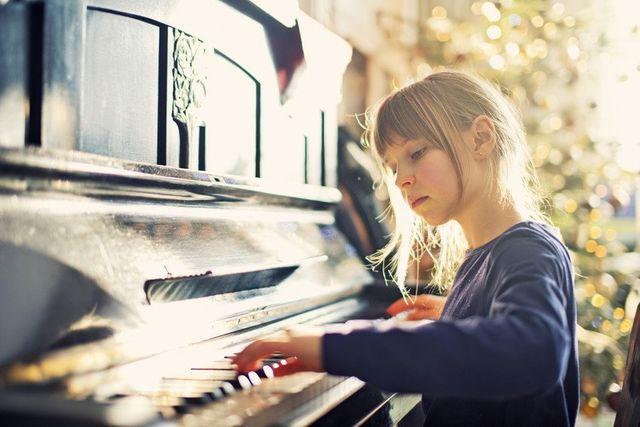 a lady playing piano