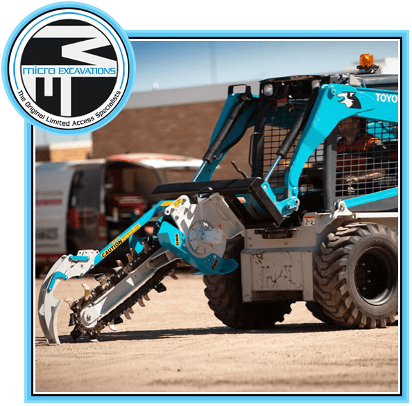 man operating sky blue chain trencher