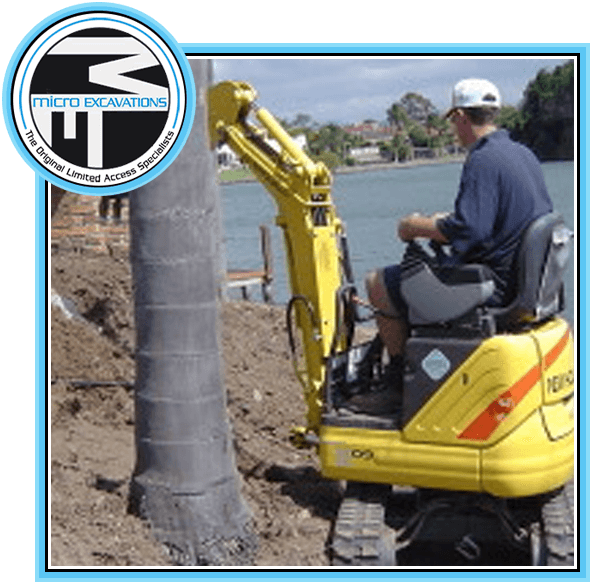 man operating yellow micro excavator