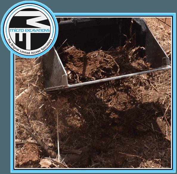 excavator pulling up soil