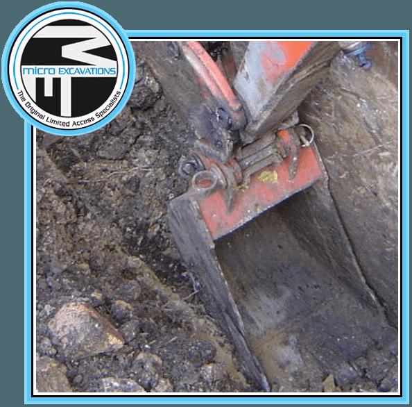digging using red orange excavator