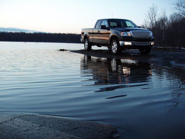 pickup truck near water