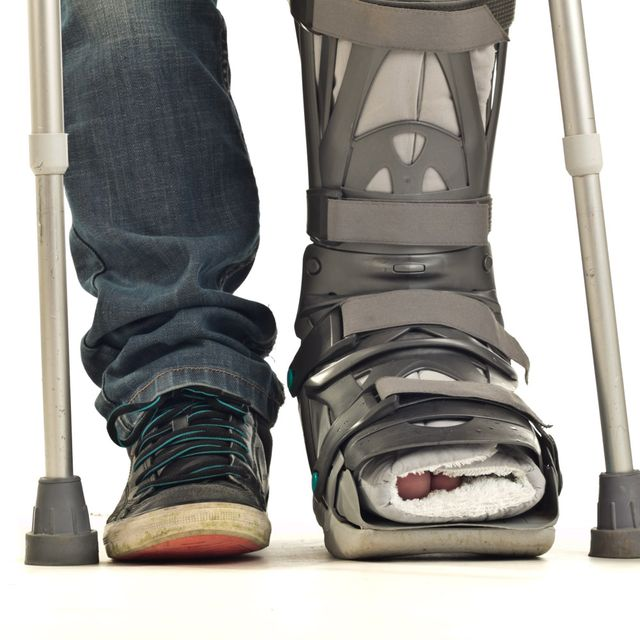 A person with a leg injury on crutches