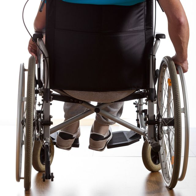 Man in wheelchair, seen from behind