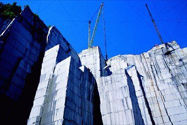 Photo Of Cranes Lifting Slabs Granite In A Quarry