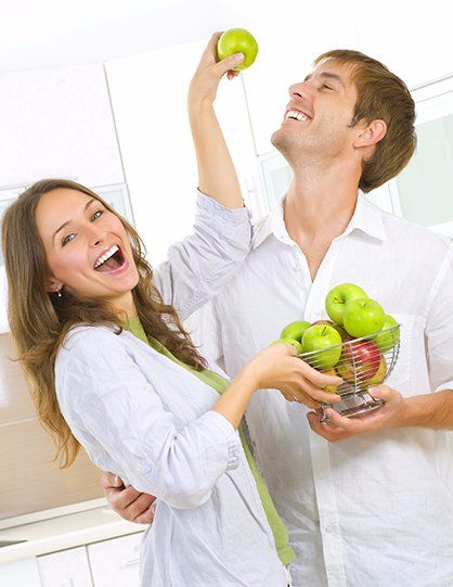 Couple having Fresh apples