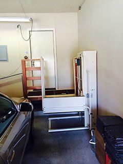 Vertical wheelchair lifts