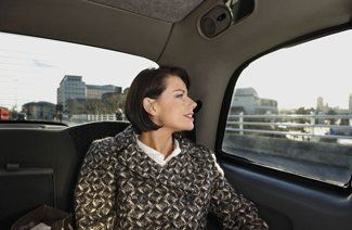 woman travelling in cab