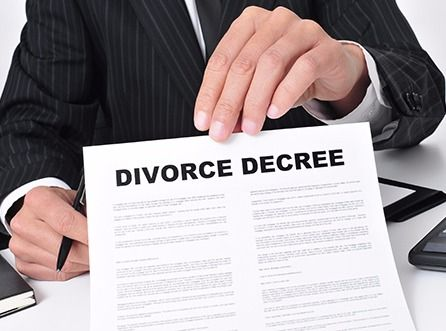 A divorce attorney assisting a client with legal paperwork in Anchorage, AK