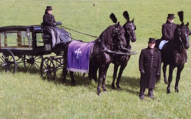 coffin pulled by horse and carriage