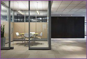 A small office breakout room behind a glass partition
