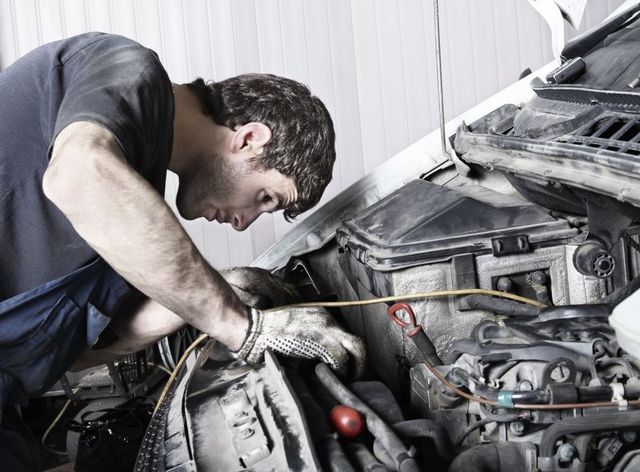 Mechanic doing auto repair and service for a client in Cameron, NC