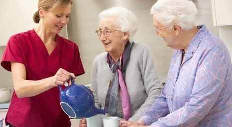 care worker serving tea
