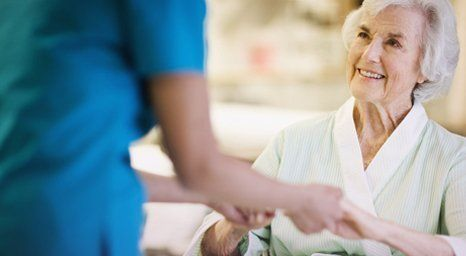 an elderly being assisted