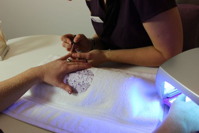 Image of a nail gel treatment being undertaken