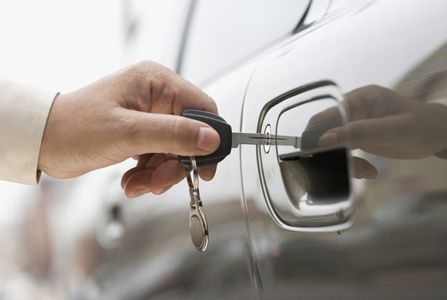 man opening the car with a key