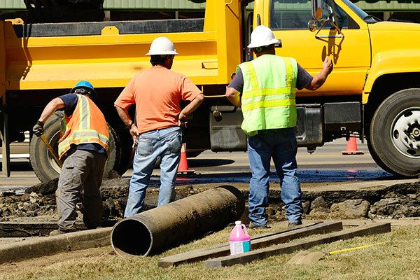 Dedicated team working on water pipes