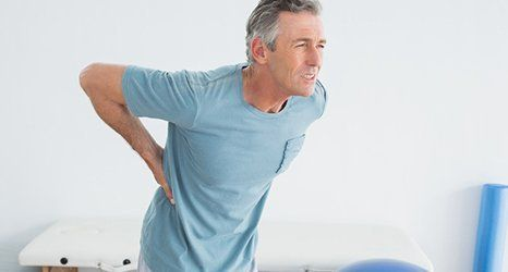 man suffering with a back pain