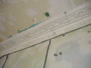 Broken plaster cornice which needs plastering repairs