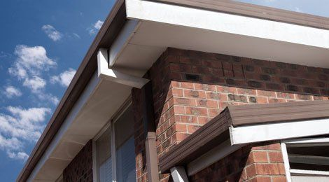 Flat roof with white uPVC fascia