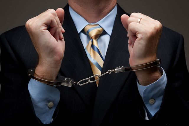 Manin in handcuffs who needs a criminal defense lawyer in Soldotna, AK
