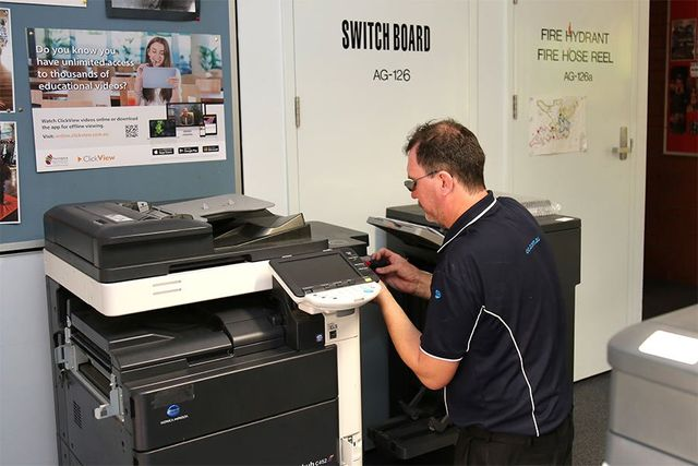 office everything employee working on photocopier