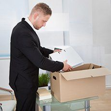 A man packing files into a box