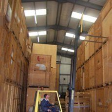 A forklift truck moving boxes