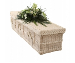 White coffin with a flower bouquet