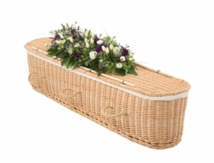 Funeral flowers decorated on a coffin