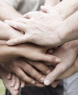 group of hands stacked in agreement