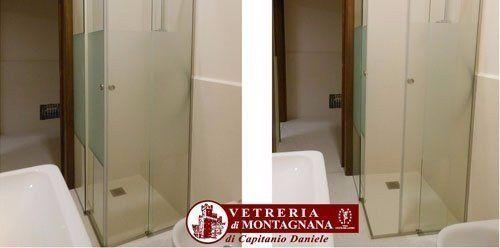 bagno bianco con box doccia in vetro