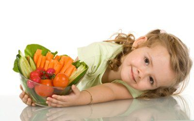 girl with a bowl of fresh vegetables