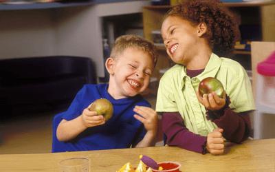 children enjoying a fruit