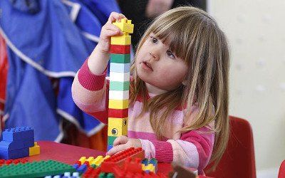 child playing with the building toys