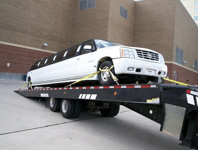 Allstar towing hauling a limo